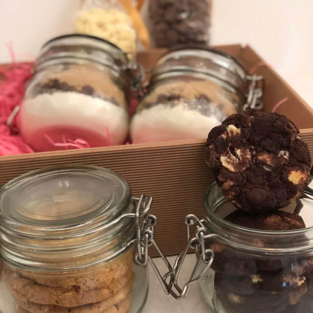 Bakers cookie hamper includes 2 jars of 'make your own cookies' 2 jars of freshly baked cookies plus 2 bags of chocolate drops.
