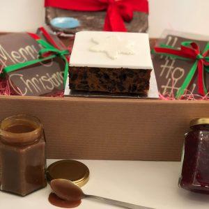 Hamper includes Fruit cake, jam, salted caramel, chocolate tiles